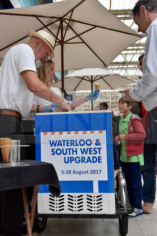 © Licensed to London News Pictures. 07/08/2017. London, UK. An ice cream seller advertises the station upgrade on his cart.  Rail passengers face disruption at Waterloo station where nearly half the platforms have been closed until August 28 for a station upgrade.  Photo credit : Stephen Chung/LNP