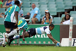Kurtley Beale dives over to score a try. NSW Waratahs v Fiji. Investec Super Rugby Preseason match, 04 February 2011 SYdney Football Stadium, Australia. Photo: Clay Cross / photosport.co.nz