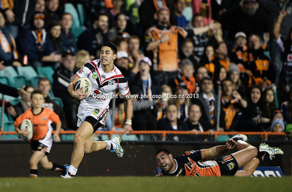 Shaun Johnson breaks out for his second try. NRL Rugby League match, Vodafone Warriors v Wests Tigers at Leichhardt Oval in Sydney, Australia on Friday 19 July 2013. Photo: Andrew Cornaga/Photosport.co.nz