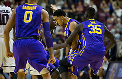 LSU guard Tremont Waters (3) is swarmed by teammates as time expires on an NCAA college basketball game against Texas A&M Saturday, Jan. 6, 2018, in College Station, Texas. Waters hit a three point shot with .7 seconds left to go ahead of Texas A&M. (AP Photo/Sam Craft)