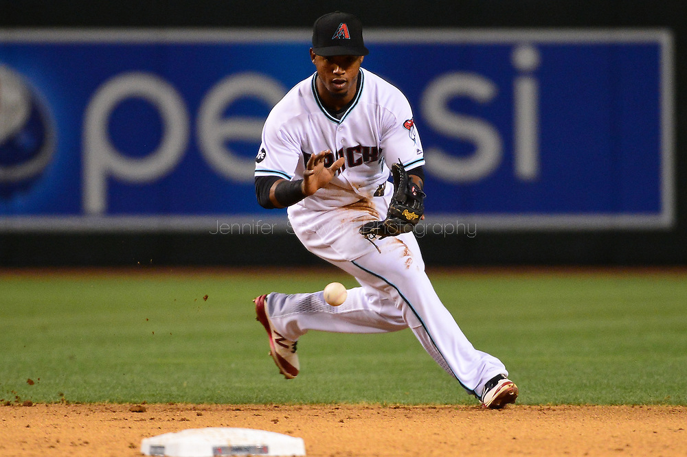 Apr 29, 2016; Phoenix, AZ, USA; Arizona Diamondbacks second baseman Jean Segura (2) fields a ground ball in the sixth inning of the game against the Colorado Rockies at Chase Field. Mandatory Credit: Jennifer Stewart-USA TODAY Sports