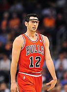Nov. 14, 2012; Phoenix, AZ, USA; Chicago Bulls guard Kirk Hinrich (12) walks up the court during the game against the Phoenix Suns at the US Airways Center. The Bulls defeated the Suns 112-106 in overtime. Mandatory Credit: Jennifer Stewart-USA TODAY Sports.