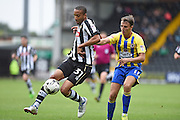 Notts County defender Thierry Audel (31) battles for possession with Accrington Stanley midfielder Sean McConville (11) during the EFL Sky Bet League 2 match between Notts County and Accrington Stanley at Meadow Lane, Nottingham, England on 10 September 2016. Photo by Jon Hobley.