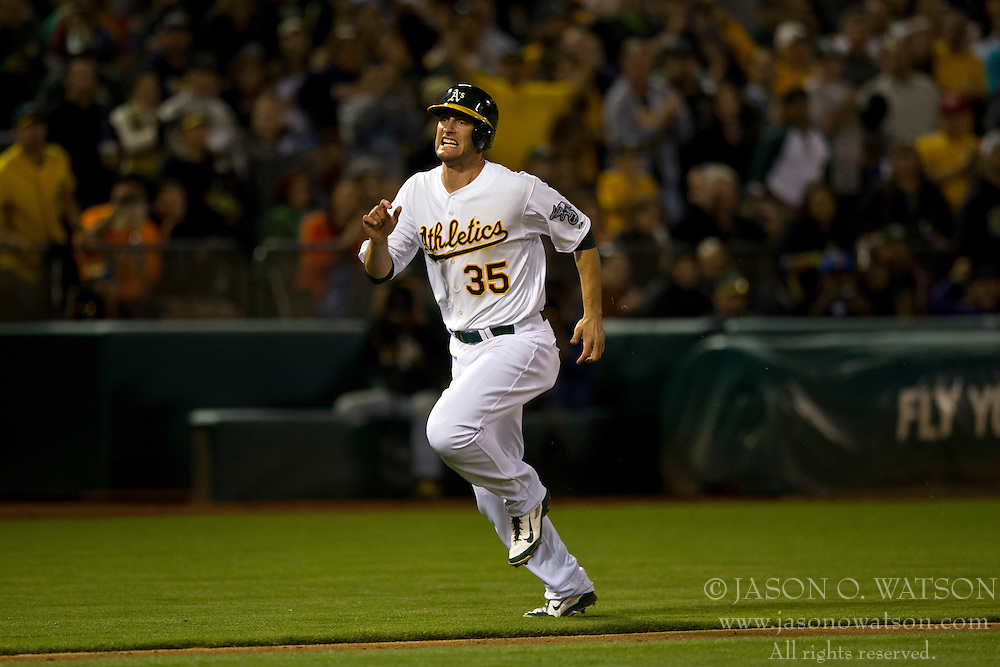 OAKLAND, CA - JULY 05:  Nate Freiman #35 of the Oakland Athletics rounds third base to score a run against the Toronto Blue Jays during the eighth inning at O.co Coliseum on July 5, 2014 in Oakland, California. The Oakland Athletics defeated the Toronto Blue Jays 5-1.  (Photo by Jason O. Watson/Getty Images) *** Local Caption *** Nate Freiman