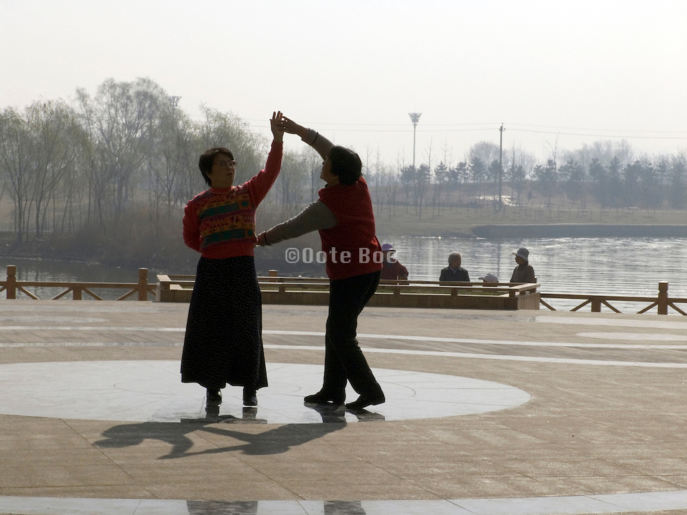 couple practicing a dance movement in Chaoyang park in Beijing China