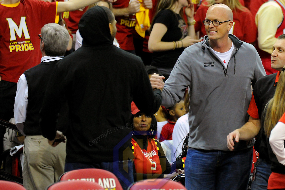 16 February 2013:   ESPN host, Scott Van Pelt (R) greets former Maryland Terrapins player, Byron Mouton (L) prior to the game between the Duke Blue Devils and the Maryland Terrapins at the Comcast Center in College Park, MD. where the Maryland Terrapins upset the second ranked Duke Blue Devils, 83-81.