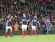 Fellow Dundee fan Cammy Kerr and  former Dee Giorgi Nemsadze congratulate Charlie Adam on his goal- Crystal Palace v Dundee - Julian Speroni testimonial match at Selhurst Park<br /> <br />  - © David Young - www.davidyoungphoto.co.uk - email: davidyoungphoto@gmail.com