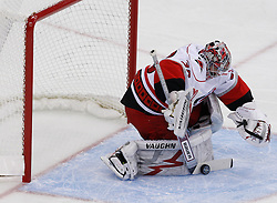 Apr 23, 2009; Newark, NJ, USA; Carolina Hurricanes goalie Cam Ward (30) makes a save during the first period of game five of the eastern conference quarterfinals of the 2009 Stanley Cup playoffs at the Prudential Center.