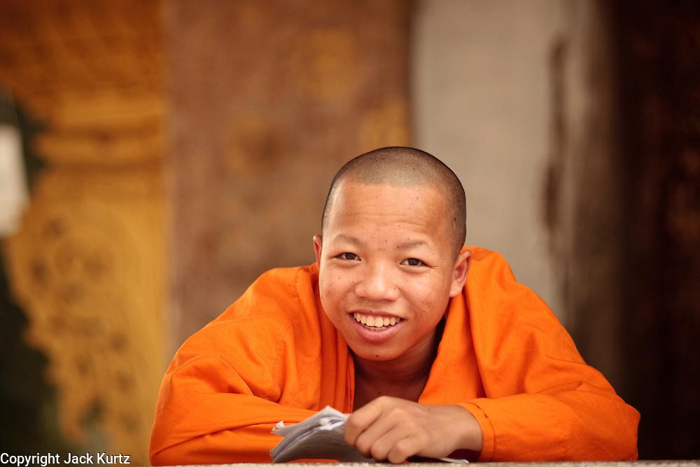 Mar. 13, 2009 -- LUANG PRABANG, LAOS:  A Buddhist monk studies at a temple in Luang Prabang, Laos.  Photo by Jack Kurtz