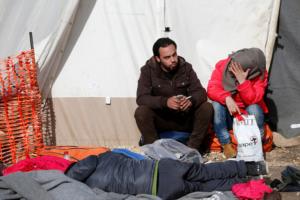 Migrants rest outside a tent as refugees and migrants wait to continue their journey towards western Europe from the Macedonia-Serbia border at a transit camp in the village of Presevo, Serbia, February 2, 2016.<br /> Photo: Darrin Zammit Lupi
