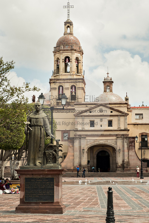 Statue of Friar Junipero Serra at the Holy Cross Church and Franciscan Convent also called the Templo y Convento de la Santa Cruz on Founders Plaza in the old colonial section of Santiago de Queretaro, Queretaro State, Mexico.