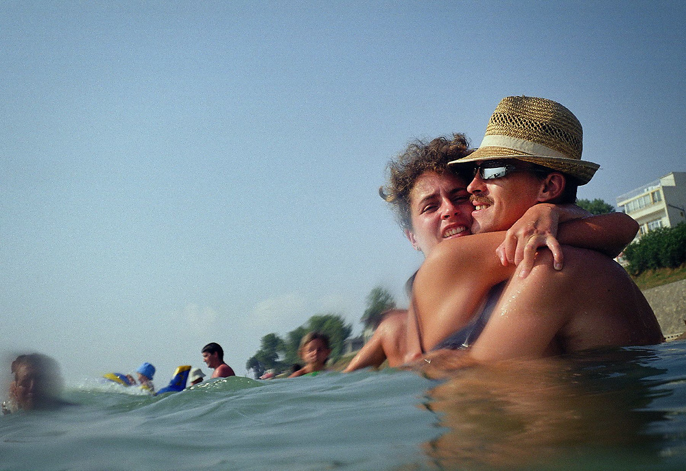 A couple embraces in the the Black Sea, Eforie Nord resort, Romania