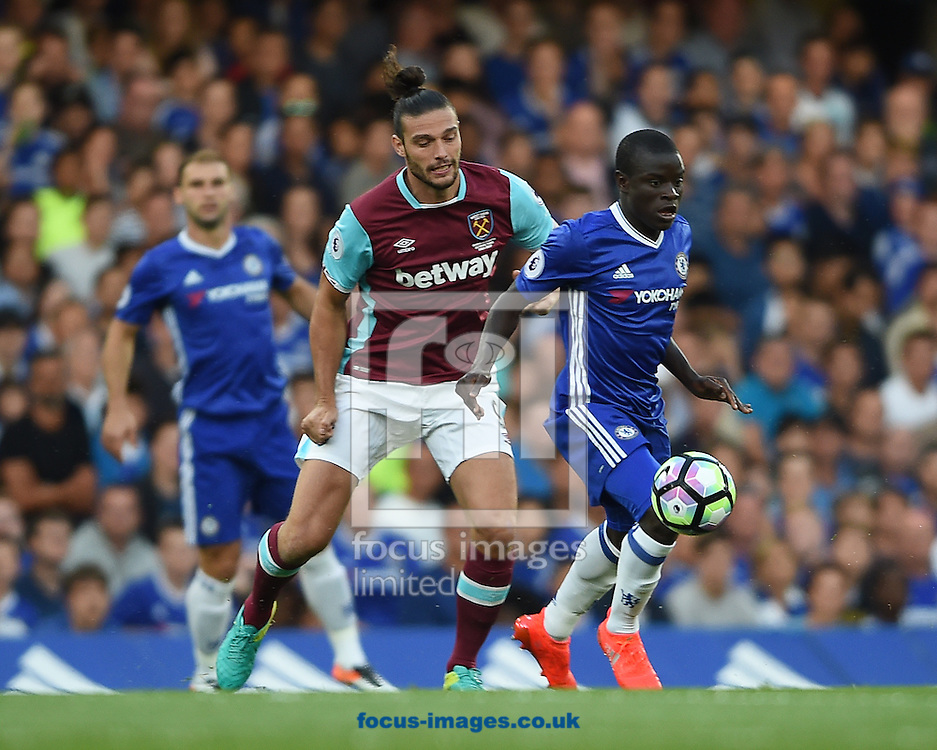 Chelsea's N&rsquo;Golo Kante of Chelsea and Andy Carroll of West Ham United during the Premier League match at Stamford Bridge, London<br /> Picture by Daniel Hambury/Focus Images Ltd +44 7813 022858<br /> 15/08/2016