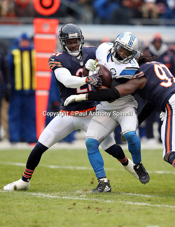 Detroit Lions running back Ameer Abdullah (21) gets gang tackled by Chicago Bears outside linebacker Willie Young (97) and Chicago Bears cornerback Tracy Porter (21) during the NFL week 17 regular season football game against the Chicago Bears on Sunday, Jan. 3, 2016 in Chicago. The Lions won the game 24-20. (©Paul Anthony Spinelli)