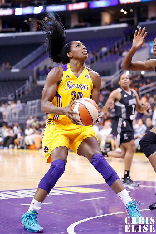 22 June 2014: forward Nneka Ogwumike (30) of the Los Angeles Sparks eyes the basket during the San Antonio Stars 72-69 victory over the Los Angeles Sparks, at the Staples Center, Los Angeles, California, USA.