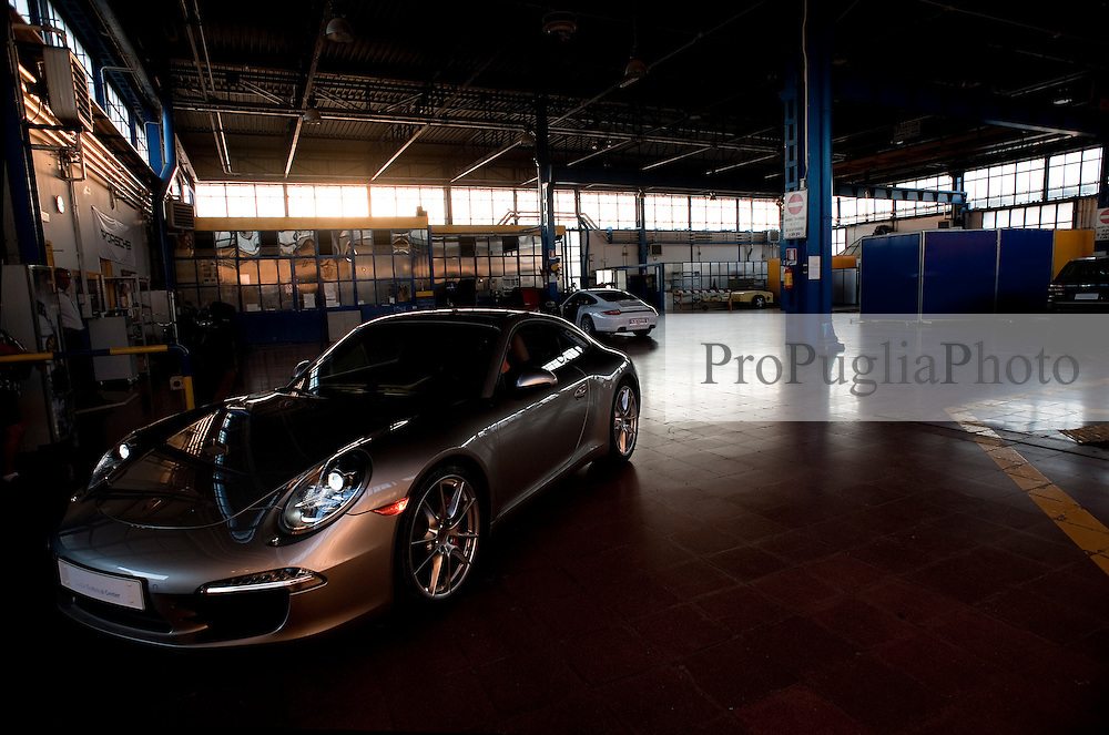 """18 August 2012.Photoreportage Nardò Techical Center Porsche Engineering ..NEWS ABOUT.Stuttgart/Nardò. In May 2012, the Porsche Engineering Group will be taking over responsibility for the Nardò Technical Center automotive proving ground in Apulia in southern Italy from Prototipo SpA. With more than 80 years experience in engineering services, the hundred per cent subsidiary of Dr. Ing. h.c. F. Porsche AG, Stuttgart, will be further optimising the test facilities and making them available to its clients for testing and trials purposes. Covering an area of more than 700 hectares, the test ground in the Province of Lecce comprises a 6.2 kilometre long handling circuit, a 12.5 kilometre long oval circuit and facilities for simulating different road surfaces and changeable weather conditions..""""The Nardò proving ground with its high-speed and vehicle handling circuit ideally complements our facilities in Weissach. With the systematic development of the company in Nardò as part of Strategy 2018, Porsche is proving to be a reliable employer and business partner in Apulia as well,"""" said Matthias Müller, President and CEO of Porsche AG..""""With its rich array of facilities, from dynamic surfaces to acoustic and off-road sections coupled with the numerous workshops, our clients can continue to make extensive use of Nardò for their vehicle trials in the future as well,"""" said Malte Radmann, CEO of Porsche Engineering. Thanks to the mild climate, the Nardò proving ground can be used throughout the year in three shifts around the clock, seven days a week..Together with the Porsche Development Centre in Weissach near Stuttgart, the Porsche Engineering Group has been offering Porsche's extensive development expertise as a service to its clients from the automotive industry and other sectors worldwide, from renting test rigs to developing complete vehicles.."""