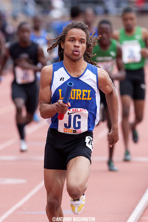 Jovan Roberson of Laurel Senior High School runs the anchor leg of the High School Boys 4x400  during the Penn Relays athletic meets on Saturday, April 28, 2012 in Philadelphia, PA.