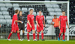 SWANSEA, ENGLAND - Friday, September 4, 2009: Wales' goalkeeper Chris Maxwell, Christian Ribeiro, Mark Bradley and Darcy Blake look dejected as Italy score an equaliser during the UEFA Under 21 Championship Qualifying Group 3 match at the Liberty Stadium. (Photo by David Rawcliffe/Propaganda)