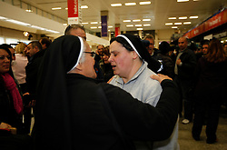A nun arriving from Tripoli on an evacuation flight is welcomed by colleagues at Malta International Airport outside Valletta February 23, 2011. .Photo by Darrin Zammit Lupi