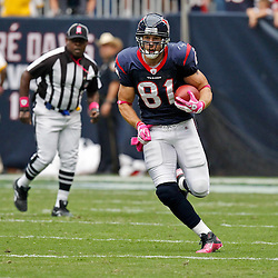 October 10, 2010; Houston, TX USA; Houston Texans tight end Owen Daniels (81) runs after a catch during the first half of a game against the New York Giants at Reliant Stadium. Mandatory Credit: Derick E. Hingle