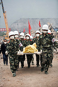 A team of Chinese soldiers carry the body of an earthquake victim in Yinghua, China.