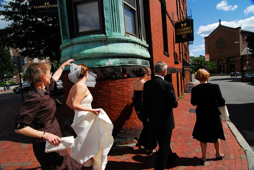A bride heads to her wedding at St. Paul Parish in Harvard Square, Cambridge, MA.