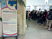 Ebola scare and awareness information poster at an airport arrival hall  Photographed at the Ben Gurion International airport, Israel