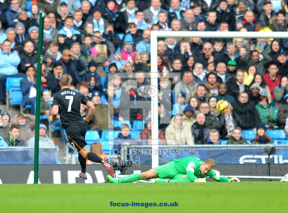 David Meyler of Hull City (left) scores the opening goal of the match during the Barclays Premier League match at the Etihad Stadium, Manchester<br /> Picture by Greg Kwasnik/Focus Images Ltd +44 7902 021456<br /> 07/02/2015