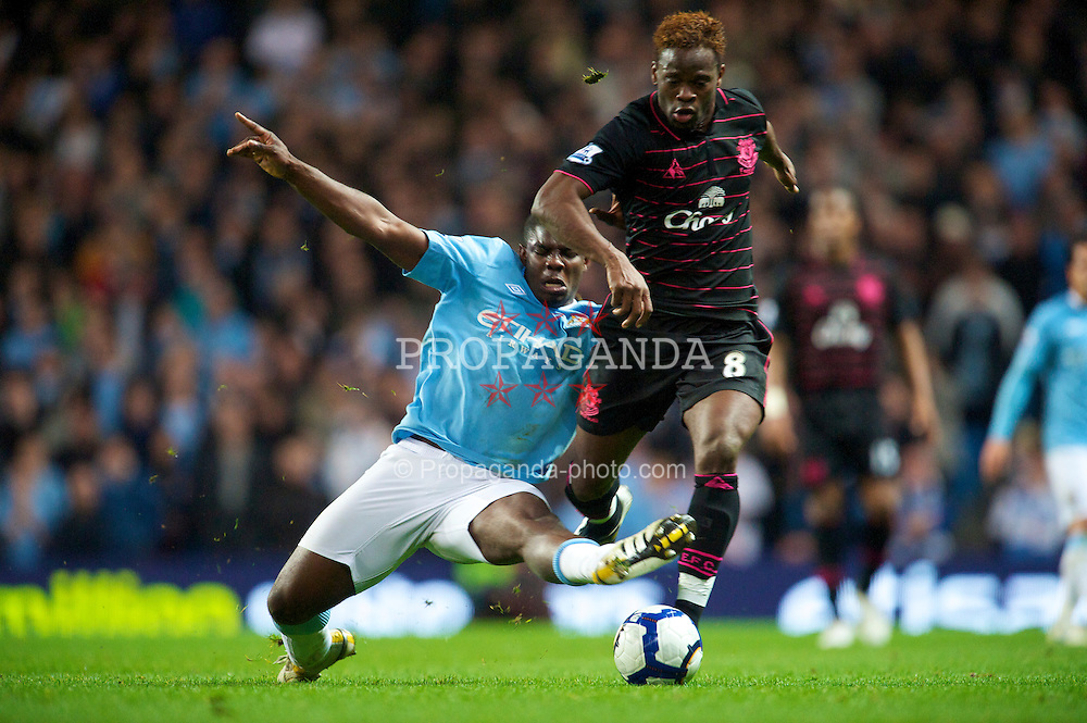 MANCHESTER, ENGLAND - Wednesday, March 24, 2010: Everton's Louis Saha and Manchester City's Micah Richards during the Premiership match at the City of Manchester Stadium. (Photo by David Rawcliffe/Propaganda)