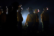 Oregon National Guard soldiers from Team 2 lay hose and set up water tanks on their first night out on the fire lines in the Columbia River Gorge..