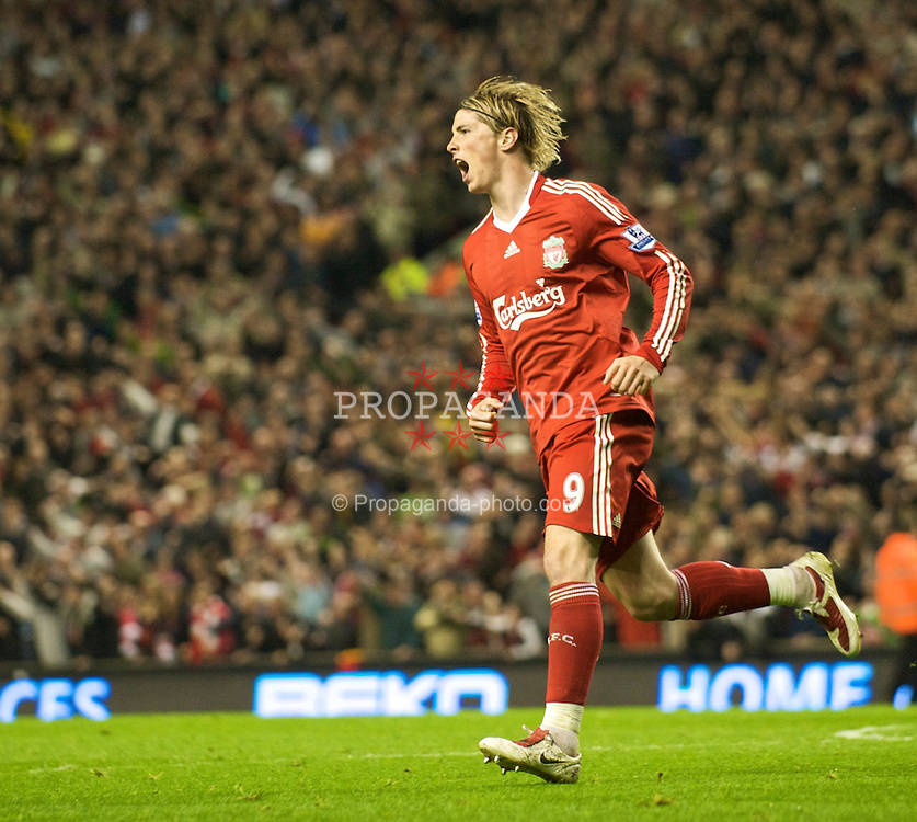 LIVERPOOL, ENGLAND - Tuesday, April 21, 2009: Liverpool's Fernando Torres celebrates scoring his side's third goal against Arsenal during the Premiership match at Anfield. (Photo by David Rawcliffe/Propaganda)