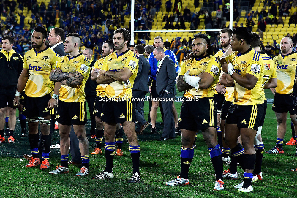 The Hurricanes stand dejected after their loss during the Super Rugby final rugby match between the Hurricanes and Highlanders at the Westpac Stadium in Wellington on Saturday the 4th of July 2015. Copyright photo by Marty Melville / www.Photosport.nz