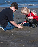 Gavin Terminie, 11, and his sister, Kaelyn Terminie, 4, play on the beach March 6, 2011 in Grand Isle, La. The island was heavily impacted by the Deepwater Horizon oil spill April 20, 2010 and continues to recover. The beach has been closed since the oil spill but re-opened in February. (Photo by Carmen K. Sisson/Cloudybright)