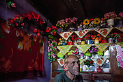 "Portrait of Stephan nicknamed ""Longa"" in his home at the Roma settlement. He is in love with flowers and has decorated his whole interior with many different types. ""Budulovskej Street"" is a segregated Roma settlement which is located about 2 km behind the Slovak village of Moldava nad Bodvou."