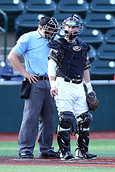 03 June 2016:  Dylan Kelly catching and Dave Fields as umpire during a Frontier League Baseball game between the Windy City Thunderbolts and the Normal CornBelters at Corn Crib Stadium on the campus of Heartland Community College in Normal Illinois