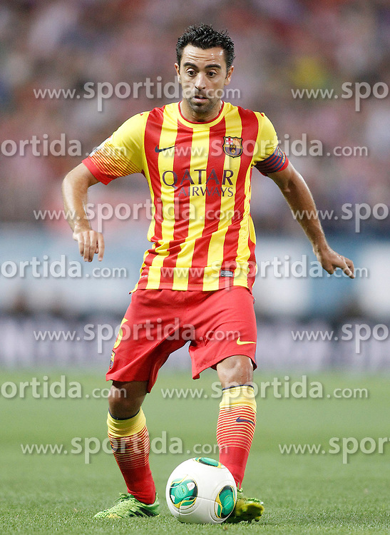 21.08.2013, Estadio Vicente Calderon, Madrid, ESP, Supercup, Atletico Madrid vs FC Barcelona, im Bild FC Barcelona's Xavi Hernandez // during during the Spanish Supercup match between Club Atletico de Madrid and Barcelona FC at the Estadio Vicente Calderon, Madrid, Spain on 2013/08/21. EXPA Pictures &copy; 2013, PhotoCredit: EXPA/ Alterphotos/ Acero<br /> <br /> ***** ATTENTION - OUT OF ESP and SUI *****