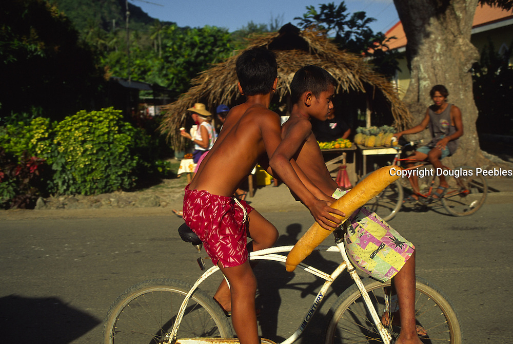 Boys with bread, Bora Bora, French Polynesia<br />