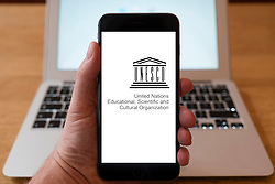 Using iPhone smart phone to display website logo of UNESCO