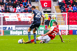 Michael Smith of Rotherham United slide tackles Murray Wallace of Millwall - Mandatory by-line: Ryan Crockett/JMP - 26/08/2018 - FOOTBALL - Aesseal New York Stadium - Rotherham, England - Rotherham United v Millwall - Sky Bet Championship