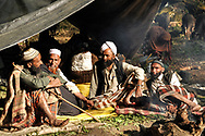 Dhumman (far right) and Yusuf (2nd from left) meet with other Van Gujjars to figure out the best strategy to move into the mountains and avoid trouble with forest rangers.