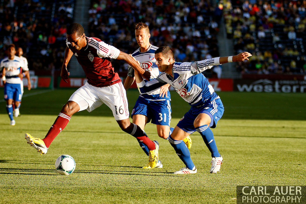 June 1st, 2013 - Colorado Rapids midfielder Atiba Harris (16) protects the ball from FC Dallas defender/midfielder Michel (31) and defender Matt Hedges (24) in first half action of the MLS match between FC Dallas and the Colorado Rapids at Dick's Sporting Goods Park in Commerce City, CO