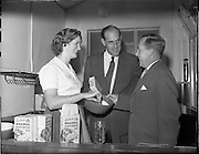 26/10/1959<br /> 10/26/1959<br /> 26 October 1959<br /> Swiss Charge d'Affairs visit to Goodbody's Factory, Dun Laoghaire, (Albright and Wilson Ireland).  Image shows the visitor being given a demonstration on mixing soda bread from Goodbody's Wholemeal Soda Bread Mix. In centre is Mr Mr. Frank Sutton, Goodbody Ltd., who accompanied the guest on the tour.