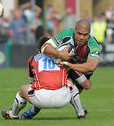 Twickenham, GREAT BRITAIN,  Harlequins' Steve SO'OIALO tackled low, by Sarries Derek HOUGAARD during the  Guinnes premiership game Harlequins vs Saracens, played at the Twickenham Stoop Stadium, Surrey on Sat. 19.09.2009.  [Photo. Peter Spurrier/Intersport-images]