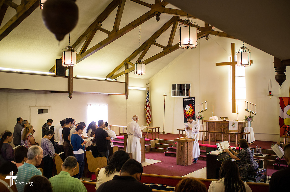 The Rev. Karl Heimer (facing altar), pastor of San Pablo Lutheran Church and president of Ysleta Lutheran Mission Human Care, leads worship at the church on Sunday, May 22, 2016, on the YLM campus in El Paso, Texas. LCMS Communications/Erik M. Lunsford