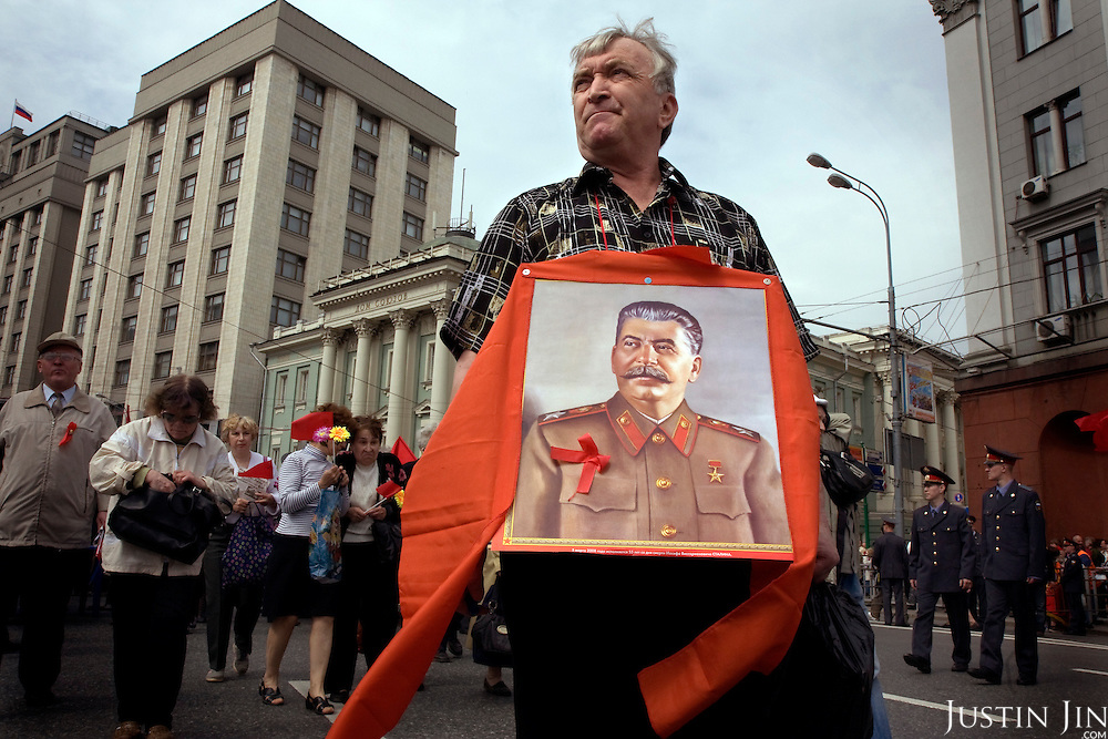 Communist supporters, carrying red flags and portraits of Lenin and Stalin, pour out on the street in Moscow on Labour Day to demonstrate.