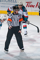 KELOWNA, CANADA - JANUARY 23: A WHL referee prepares to drop the puck between the Kelowna Rockets and the Everett Silvertips on January 23, 2015 at Prospera Place in Kelowna, British Columbia, Canada.  (Photo by Marissa Baecker/Shoot the Breeze)  *** Local Caption *** Referee; official;