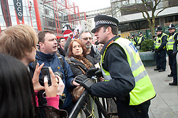 "Police deal with one of the demos speakers as he sits on the ""ring of Steel"" and chants anti Government slogans  in  Barkers Pool, outside Sheffield city Hall where the Liberal Democrats are holding their Party conference Conference Sheffield Saturday.12 March 2011.Images © Paul David Drabble"