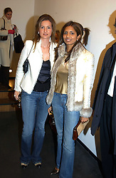 Left to right, LAURA PIGORINI and DIVIA LALVANI at an exhibition of photographs by Matthew Mellon entitled Famous Feet - featuring well known people wearing shoes from Harrys of London, held at Hamiltons Gallery, Carlos Place, London on 22nd November 2004.<br />