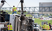 Crews from Jordan and J&J towing companies work to upright an overturned Cardinal Coach Line charter bus on Hwy. 161 near N. Belt Line Rd.  in Irving on Thursday, April 11, 2013. The accident resulted in two deaths and 41 hospitalized. (Cooper Neill/The Dallas Morning News)