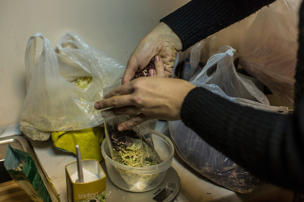 DNIPROPETROVSK, UKRAINE - NOVEMBER 16, 2014:  Tatyana Sirko, 42, a gynecologist, packages the dried ingredients for traditional borscht soup in the kitchen at the Dnipropetrovsk Volunteer Logistics Center, a charity organization that produces supplies for pro-Ukrainian fighters battling rebels in the country's East, in Dnipropetrovsk, Ukraine. CREDIT: Brendan Hoffman for The New York Times